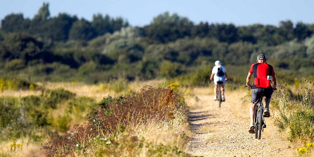 Visit Milford on Sea 2 people Cycling on a path